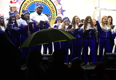 12/2/2016 Mike Orazzi | Staff Southington High School cheerleaders sing on Southington Town Green during the Southington Hospitality Night held on the town greens in Plantsville and Southington Friday evening.