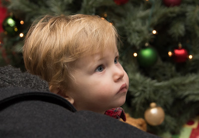 120216  Wesley Bunnell | Staff  Cullen O'Neil, age 20 months, looks up at the decorations during Santa's Workshop. The event was held on Friday evening at the Mortensen Community Center in Newington.