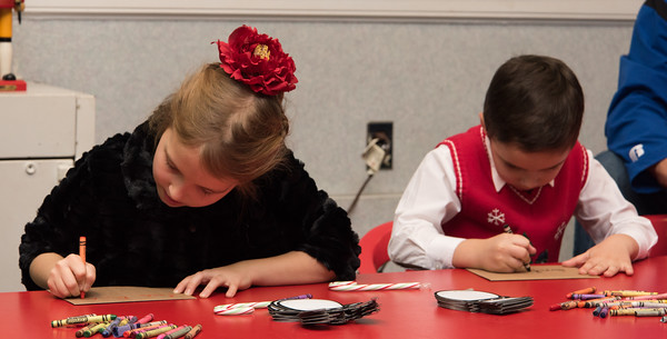 120216  Wesley Bunnell | Staff  Sasha Brokin, age 7 shown left, sits with her brother Daniel Brokin, age 5, as they put the finishing touches on their letters to Santa. Santa's Workshop was held on Friday evening at the Mortensen Community Center in Newington.