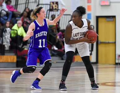 121316  Wesley Bunnell | Staff  New Britain girls basketball was defeated by visiting Bristol Eastern Thursday night at New Britain High School. New Britain's Dejia Santana (10) with Bristol Eastern's Hannah Maghini (11).