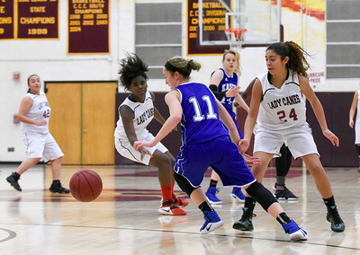 121316  Wesley Bunnell | Staff  New Britain girls basketball was defeated by visiting Bristol Eastern Thursday night at New Britain High School. Bristol Eastern's Hannah Maghini (11) takes the ball up court against New Britain's Savannah Gonzalez (24).