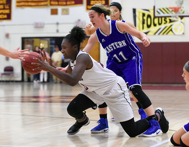 121316  Wesley Bunnell | Staff  New Britain girls basketball was defeated by visiting Bristol Eastern Thursday night at New Britain High School. New Britain's Dejia Santana (10) is on the floor fighting for a loose ball with Bristol Eastern's Hannah Maghini (11).