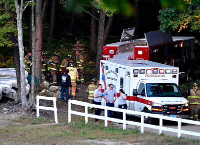 10/6/2016 Mike Orazzi | Staff Terryville firefighters carry the pilot of an experimental aircraft that crashed near The Waterbury Airport in Plymouth Thursday evening. The pilot was flown by Life Star helicopter to Hartford Hospital.