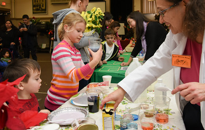 122716  Wesley Bunnell | Staff  The Bristol Historical Society held Winter Wonderland II on Tuesday Dec 27 with kid friend activities and movies. Maia Nocera, age 9, mixes household ingredients at the Magic of Science table.
