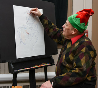 122716  Wesley Bunnell | Staff  The Bristol Historical Society held Winter Wonderland II on Tuesday Dec 27 with kid friend activities and movies. Cortland Hull works on a Dumbo drawing.