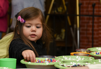 122716  Wesley Bunnell | Staff  The Bristol Historical Society held Winter Wonderland II on Tuesday Dec 27 with kid friend activities and movies. Josslin Landry, age 3, picks out beads to make a necklace.