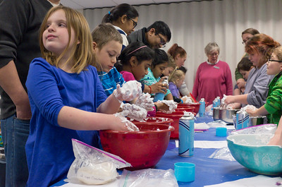 122816  Wesley Bunnell | Staff  Plainville's public library held Magical Mixtures on Wednesday Dec 28 for elementary aged children. Dani Alff, age 9 shown left, works on a snow mixture of shaving cream and powder.