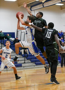 f122816  Wesley Bunnell | Staff  Southington boys basketball vs Weaver High School on Wednesday evening at Southington High School. Southington guard Michael DeFeo (2).