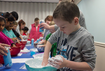 122816  Wesley Bunnell | Staff  Plainville's public library held Magical Mixtures on Wednesday Dec 28 for elementary aged children. Darren Paznokas, age 7, works on a snow mixture of shaving cream and powder.