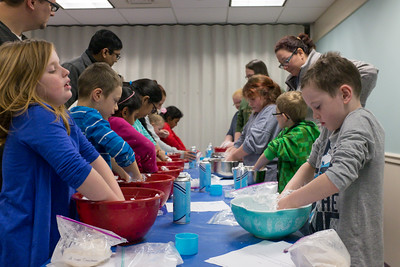 122816  Wesley Bunnell | Staff  Plainville's public library held Magical Mixtures on Wednesday Dec 28 for elementary aged children. Dani Alff, age 9 shown left, works on a snow mixture of shaving cream and powder alongside Darren Paznokas, age 7 shown right.