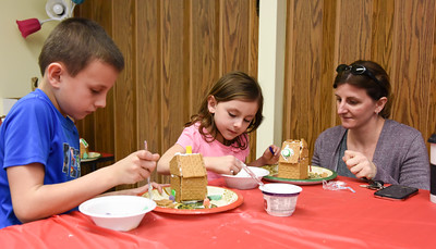 122816  Wesley Bunnell | Staff  The New Britain Children's Museum held a gingerbread house making class on Wednesday Dec 28. Mom Jackie Andrade with her children Tyler Andrade, age 7 shown left, and Rayna Andrade, age 4.