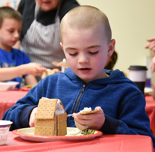 122816  Wesley Bunnell | Staff  The New Britain Children's Museum held a gingerbread house making class on Wednesday Dec 28. Nathan Tiano, age 7, working on his gingerbread house.