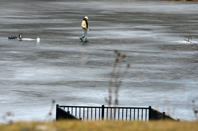 12/28/2016 Mike Orazzi | Staff Curtis Mitte while ice fishing on Birge Pond in Bristol Wednesday morning prompting calls to the Bristol police, fire and parks department. Mitte was asked to leave by police because of the possibility of thin ice.