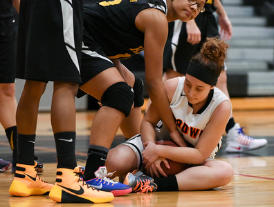 122916  Wesley Bunnell   Staff  E.C. Goodwin girls basketball came away with the runner up trophy in the Goodwin Tech Holiday Basketball Classic Tournament. Tatyana Vazquez (22) fights for the ball.