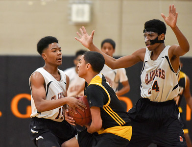 122916  Wesley Bunnell | Staff  E.C. Goodwin boys basketball vs Kaynor Tech in the final game of the Goodwin Tech Holiday Basketball Classic Tournament. Josh Peeples (15) fights for the ball with the help of Luis Aguiar (24) right.