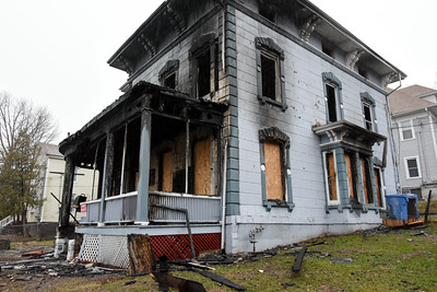 122916  Wesley Bunnell | Staff  The fire damaged home at 51 Prospect St in New Britain.