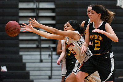 122916  Wesley Bunnell   Staff  E.C. Goodwin girls basketball came away with the runner up trophy in the Goodwin Tech Holiday Basketball Classic Tournament. Tazmaira Baerga (21) reaches for the ball as it goes out of bounds.