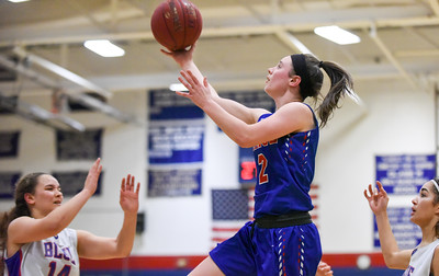 123016  Wesley Bunnell | Staff  St. Paul girls basketball defeated Plainville at Plainville High School on Friday evening. Guard Brigid Johndrow (2)