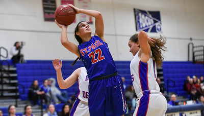 123016  Wesley Bunnell | Staff  St. Paul girls basketball defeated Plainville at Plainville High School on Friday evening. Forward Amelia Sanchez (22)