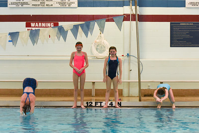 123016  Wesley Bunnell | Staff  Family swim days were held on Dec 29 and Dec 30 at Plainville High School. From left jumping in the pool is Emma Miller age 12, Lilly Wazorko age 12, Hannah Miller age 9 and Olivia Lagassey age 7.