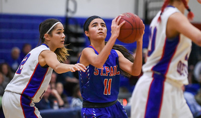 123016  Wesley Bunnell | Staff  St. Paul girls basketball defeated Plainville at Plainville High School on Friday evening. Forward Chantell-Marie Lopez (11)