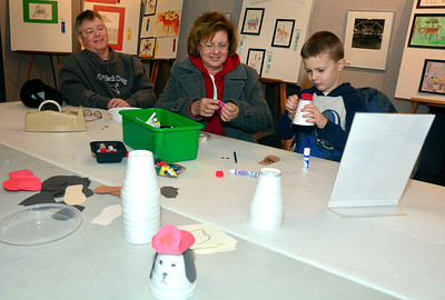 12/30/2016 Mike Orazzi | Staff Hunter Caron while working on crafts at the New England Carousel Museum as part of vacation week activities with his grandparents Pete Ledwith and Joanne Varneke Friday afternoon.