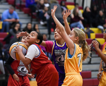 122216  Wesley Bunnell | Staff  Players from the New Britain Junior Lady Hurricanes Basketball League played for the crowd during the half at the New Britain High School girls basketball game on Dec 22. Jayona White with a shot attempt.