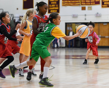 122216  Wesley Bunnell | Staff  Players from the New Britain Junior Lady Hurricanes Basketball League played for the crowd during the half at the New Britain High School girls basketball game on Dec 22. Deborah White, center, and Aniah Faienza with the ball.