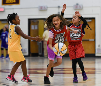 122216  Wesley Bunnell | Staff  Players from the New Britain Junior Lady Hurricanes Basketball League played for the crowd during the half at the New Britain High School girls basketball game on Dec 22. From left Jadian Palmer, Tenaena Pelletier with the ball and Jazinyah Garcia.