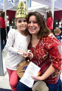 12/31/2016 Mike Orazzi | Staff Jennifer Shaffer and her daughter Isabella,4, during the 11th Annual Celebrations around the World at the Imagine Nation in Bristol Saturday.