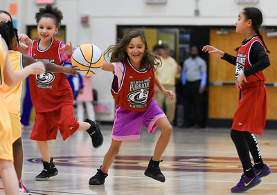 122216  Wesley Bunnell | Staff  Players from the New Britain Junior Lady Hurricanes Basketball League played for the crowd during the half at the New Britain High School girls basketball game on Dec 22.  Tenaena Pelletier dribbles downcourt.