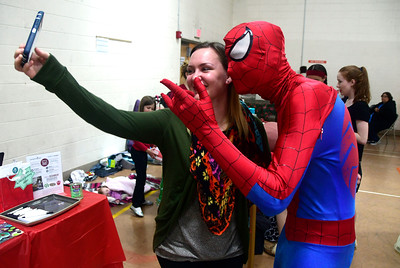 12/3/2016 Mike Orazzi | Staff Amber Ruff photographs herself with Spiderman, Anthony Kosienski, during the  New Britain YWCA's Winter Wonderland Weekend on Saturday.