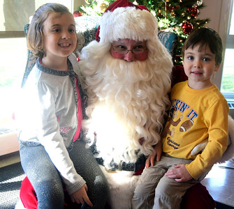 "12/3/2016 Mike Orazzi | Staff Annie and Nate Vastola meet with Santa, Bob Boudreau, during the Giamatti Little League Center's ""23rd Annual Breakfast with Santa Saturday morning."