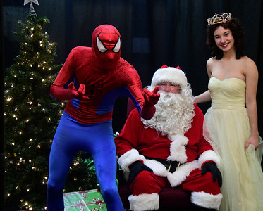 12/3/2016 Mike Orazzi | Staff Spiderman, Anthony Kosienski, and Princess Belle, Carson Stifel with Santa John Stephenson, during the New Britain YWCA's Winter Wonderland Weekend on Saturday.