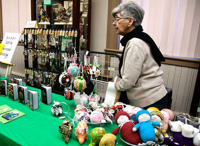 12/3/2016 Mike Orazzi | Staff AnnMarie Bukowiec sells her creations during the 10th Annual Holiday Craft Fair held at the Bristol Historical Society Saturday.