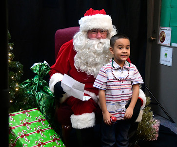 12/3/2016 Mike Orazzi | Staff Alexis Cendeo meets with Santa John Stephenson, during the New Britain YWCA's Winter Wonderland Weekend on Saturday.