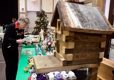 12/3/2016 Mike Orazzi | Staff Mary Houle makes a purchase during the 10th Annual Holiday Craft Fair held at the Bristol Historical Society Saturday.