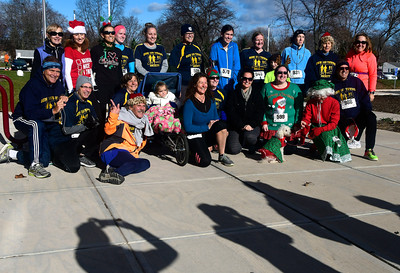 12/3/2016 Mike Orazzi | Staff Runners during the 32nd installment of the Annual Tinsel Fun Run at Berlin High School Saturday morning put on by the Berlin YMCA and the Berlin Parks and Recreation Department.