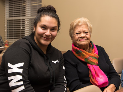 120516 Wesley Bunnell | Staff  OIC in conjunction with high school students got together on Monday afternoon at the Burritt School Apartments for a Christmas party with elderly residents of the building. Junior at New Britain High Alexandra Collazo, left, with resident Carmin Rosado.