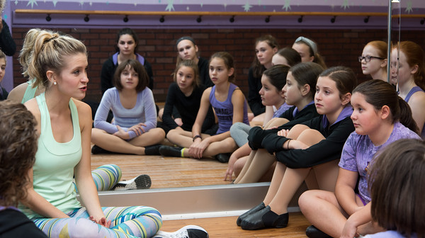 120616 Wesley Bunnell | Staff  Actress Allison Bailey who is the understudy for Glinda in the WICKED Broadway National Tour speaks to captivated students at Dance Legacy Caroline's Dance Center on Tuesday afternoon.