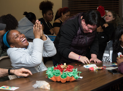 120616 Wesley Bunnell | Staff  OIC in conjunction with high school students got together on Tuesday afternoon at the Nathan Hale Apartments for a Christmas party with elderly residents of the building. New Britain High School Senior Nadia Varela, left, laughs with  Bingo partner Diana Garcia after winning Bingo.