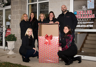 120616 Wesley Bunnell | Staff  Members of the Teremzi Team are from left , Buyer Specialist Shannen Tack, Buyer Specialist Paula Bouchard, Buyer Specialist Alycia Zalewski, Lead Buyer Specialist Kristen DellaVecchia, Listing Manager Meghan Sidoti, Listing Specialist Ryan Raymond and Executive Assistant Megan Leigh Burg. Members not present are Listing Specialist Tyler Phelps, Buyer Specialist Maite Vasquez and CEO of Team Terenzi Sandie Terenzi.