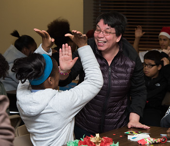 120616 Wesley Bunnell | Staff  OIC in conjunction with high school students got together on Tuesday afternoon at the Nathan Hale Apartments for a Christmas party with elderly residents of the building. New Britain High School Senior Nadia Varela, left, congratulates Bingo partner Diana Garcia after winning Bingo.