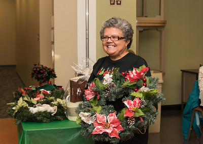 120916 Wesley Bunnell | Staff  The New Britain Senior Center held their holiday bazaar featuring hand made items for sale on Friday Dec 9. Esperanza Tirado win a wreath and candy in one of the many raffle drawings held.