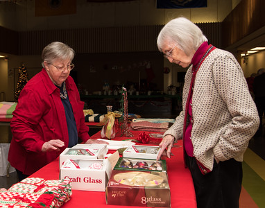 120916 Wesley Bunnell | Staff  The New Britain Senior Center held their holiday bazaar featuring hand made items for sale on Friday Dec 9.  Lillian Landrie, shown left, shows her hand painted tree ornaments to Joy Rutty.