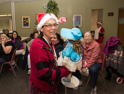 120916 Wesley Bunnell | Staff  The New Britain Senior Center held their holiday bazaar featuring hand made items for sale on Friday Dec 9.  Many raffle prizes were awarded including this doll to Joan Morgan which was donated by Phyllis Scalise Tanasi.