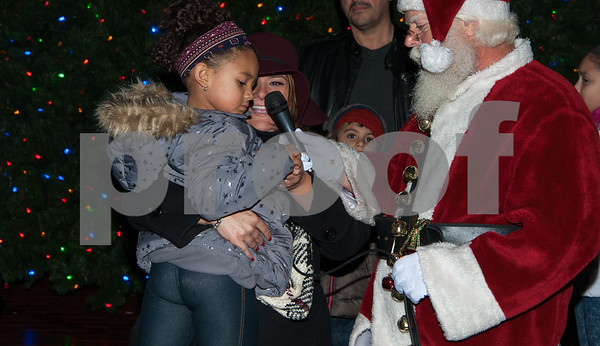 12/05/17   Wesley Bunnell | Staff  New Britain held their annual Tree Lighting at Central Park on Tuesday evening with a visit from Santa Claus. Hayden Dupree, age 4, is held by Mayor Erin Stewart as they light the tree.