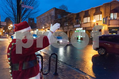 12/05/17   Wesley Bunnell | Staff  New Britain held their annual Tree Lighting at Central Park on Tuesday evening with a visit from Santa Claus. Santa waves to cars traveling down West Main St. as he waits for his ride from the fire department.