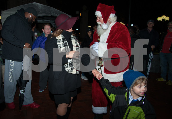 12/05/17 Wesley Bunnell | Staff New Britain held their annual Tree Lighting at Central Park on Tuesday evening with a visit from Santa Claus. Mayor Erin Stewart stops to talk with Santa as she is led through Central Park by William Petit III.
