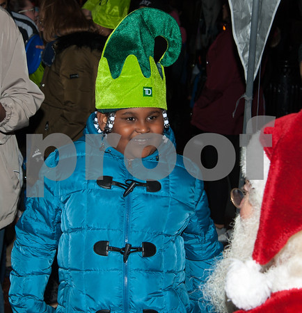 12/05/17 Wesley Bunnell | Staff New Britain held their annual Tree Lighting at Central Park on Tuesday evening with a visit from Santa Claus. Melody Rivera-Grayer, age 7, smiles as she walks up to Santa with her Christmas wishes.